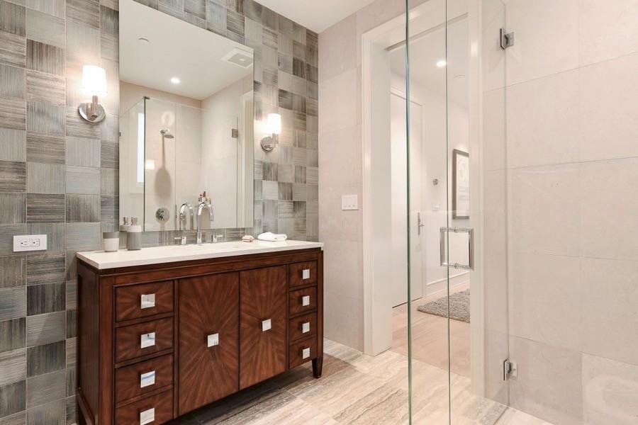 Broadway Bathroom With Elegant Narrow Vanity And Large Mirror
