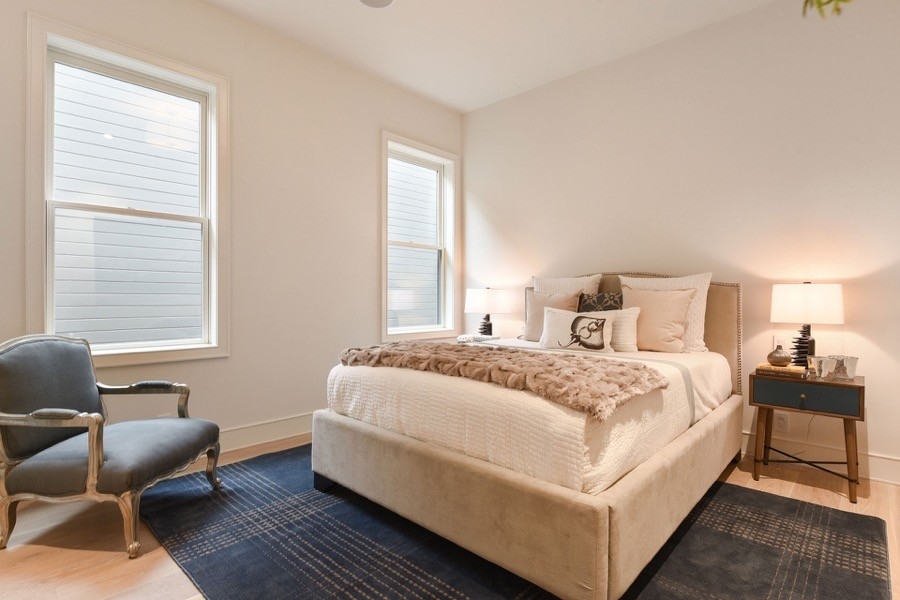 Broadway Third Bedroom With Windows, Bed, And Chair