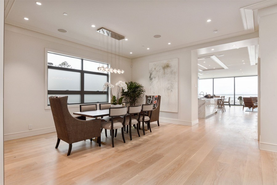 Broadway Large Open Access Dining Room With Overhead Lighting, Table And Chairs, And Natural Hardwood Floors