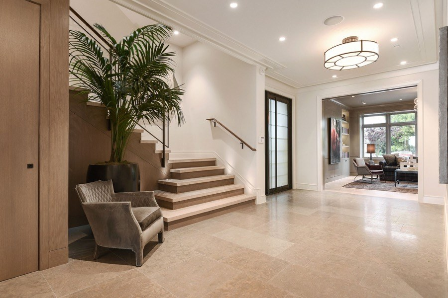 Broadway Entryway With Chair, Plant, Stairway And Living Room Access
