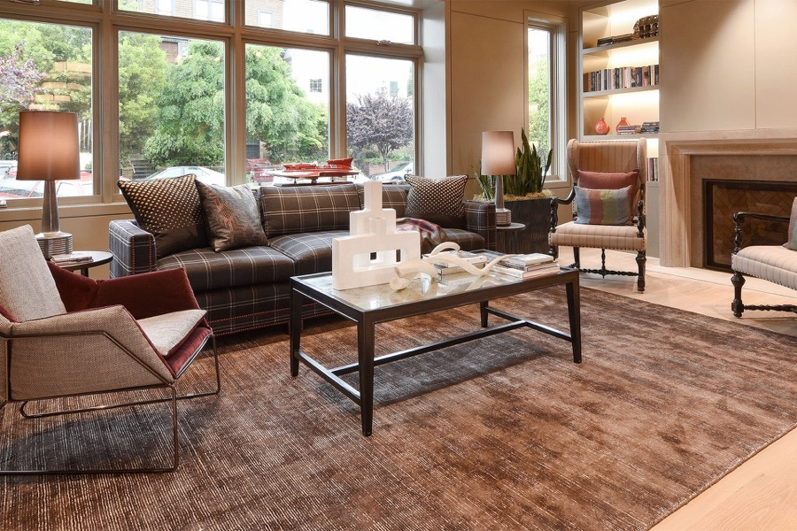 Broadway Spacious Family Room With Large Windows, Couch, Chairs, Coffee Table, Fireplace, And Decorative Rug