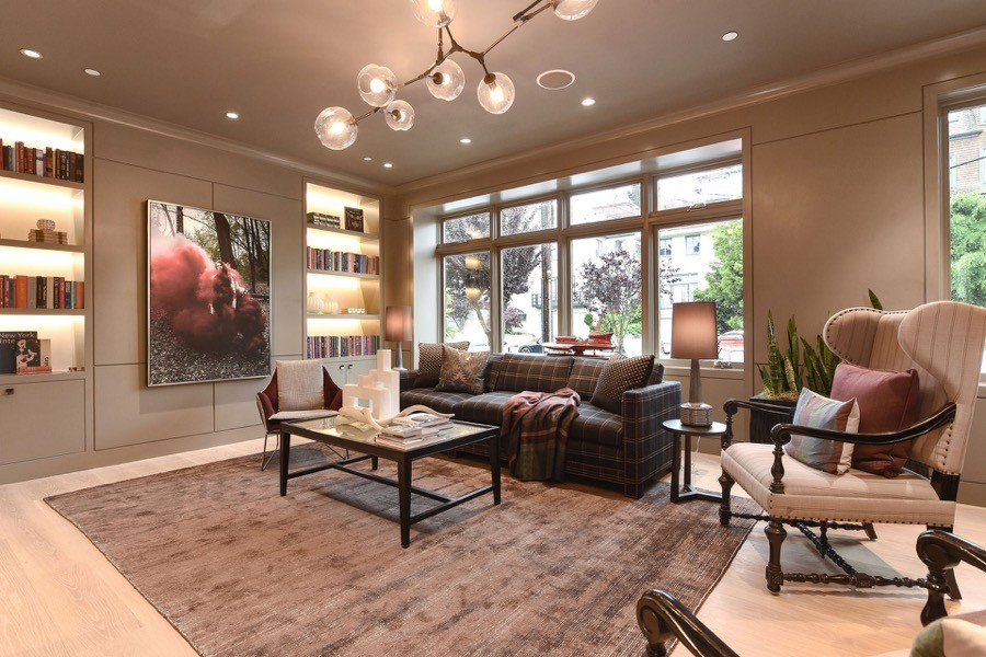 Broadway Open Living Room With Large Windows, Couch, Chairs And Coffee Table