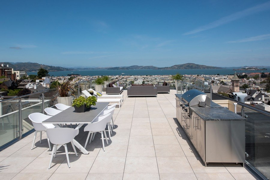 Broadway Rooftop Seating With Table And Chairs, Grill, And Unobstructed Views Of The Bay