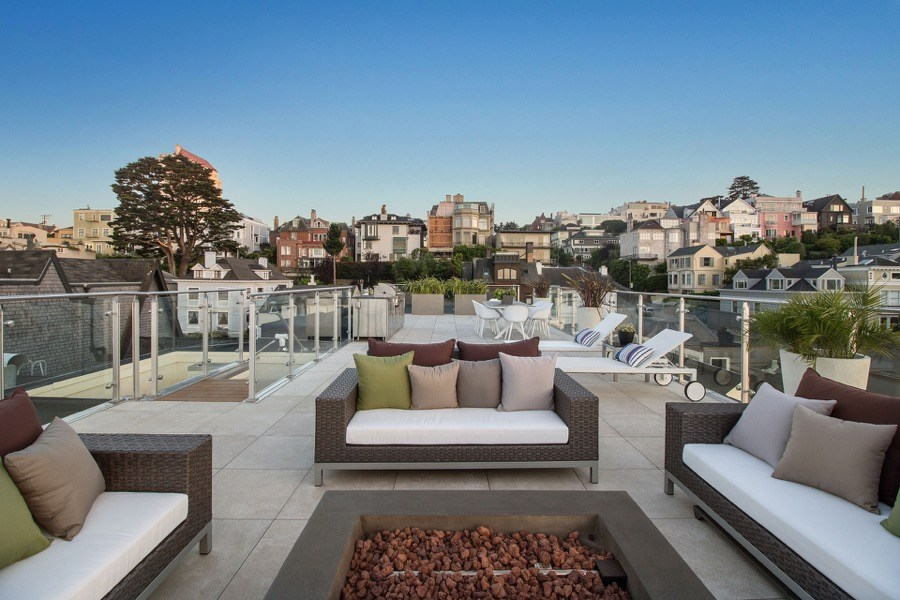 Broadway Rooftop Seating With Gas Fireplace, Wicker Patio Furniture And Residential Skyline