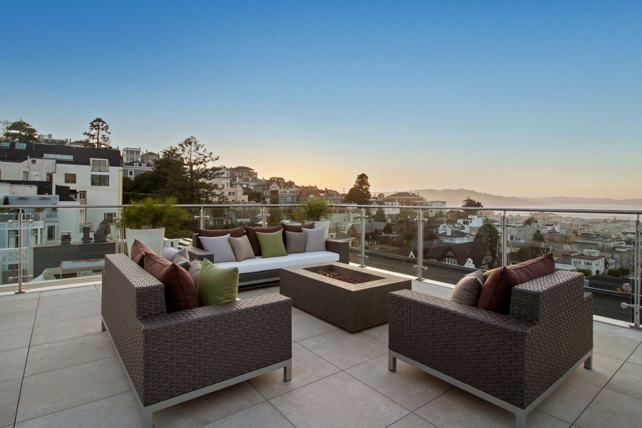 Broadway Rooftop Seating With Wicker Furniture, Fireplace And View Of The Bay