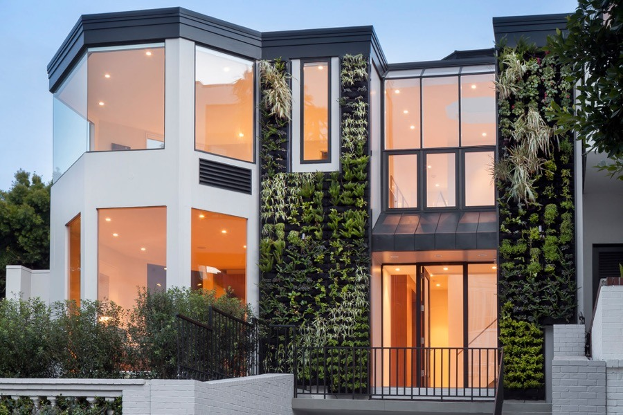 Broadway White Modern Exterior With Green Walls And Large Windows Providing Natural Light