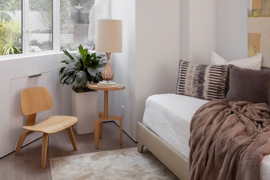 Broadway Guest Bedroom With Cozy White Interior And Natural Lighting