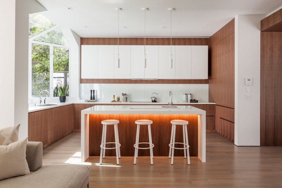 Broadway Modern Family Kitchen With Natural Lighting, Island Bar, Stools And Hanging Light Fixtures